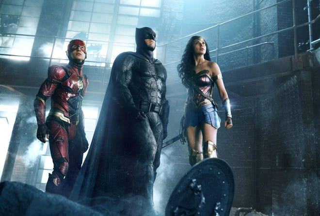 """Ezra Miller is The Flash, Ben Affleck is Batman and Gal Gadot is Wonder Woman in """"Justice League."""""""