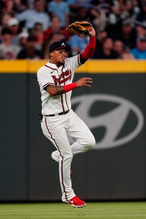 Atlanta Braves shortstop Orlando Arcia catches a line drive from Tampa Bay Rays' Austin Meadows in the eighth inning of a baseball game Saturday, July 17, 2021, in Atlanta. (AP Photo/John Bazemore)