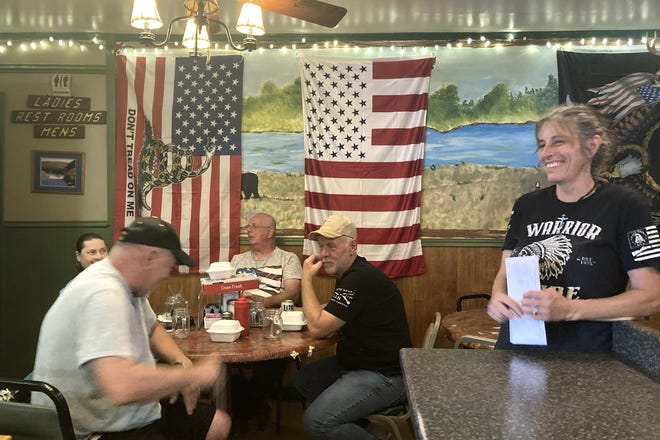 Pauline Bauer, right, speaks with customers, from left, Ron Stevenson, of Jamestown, New York; his cousin Glenn Robinson, of Kane, McKean County; and his half-brother Paul Boedecker, of Warren, Warren County, at Bauer's restaurant, Bob's Trading Post.