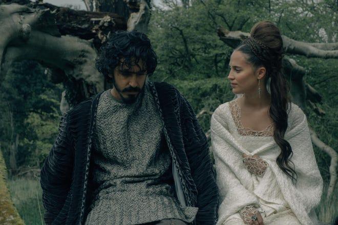 "Gawain (Dev Patel) has a chat with Lady Bertilak (Alicia Vikander) in ""The Green Knight."""