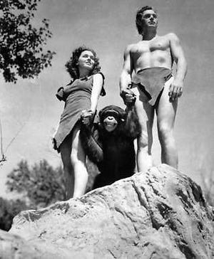 """A file photo shows Johnny Weissmuller, right, as Tarzan, Maureen O'Sullivan as Jane, and Cheetah the chimpanzee, in a scene from the 1932 movie """"Tarzan the Ape Man."""""""