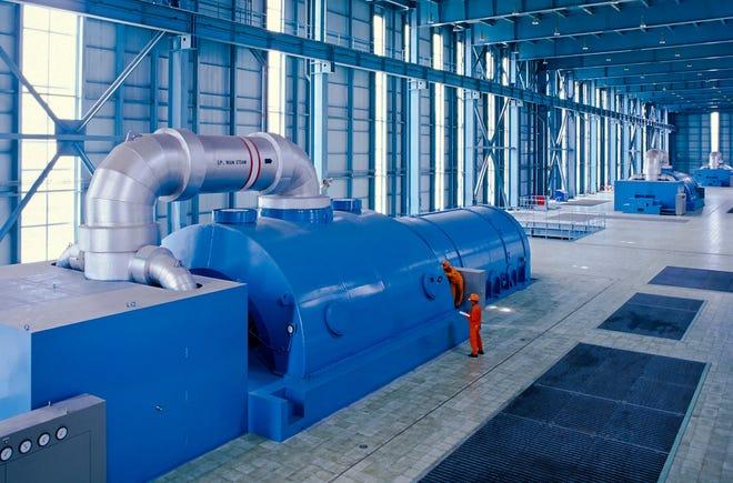 Fossil fuel turbine generating electricity.