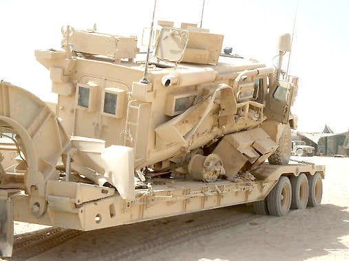 Jarod Overton and his crew endured a roadside bomb blast last year in Afghanistan, but because of the vehicle\'s MRAP design, their lives were saved. Overton, a Mooresville native, recently won the Purple Heart for his sacrifice. Submitted photo.
