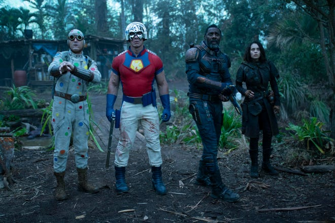 "David Dastmalchian, from left, John Cena, Idris Elba and Daniela Melchior in a scene from ""The Suicide Squad."""