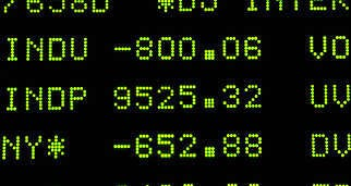 A board on the floor of the New York Stock Exchange shows the Dow Jones Industrial Average down 800 points during the trading day Monday before it recovered to close with a loss of 370.Richard Drew   Associated Press