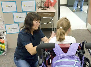 Laura Wright, a paraeducator with the Summer Academy at Summit Elementary School, works with one of the students in the special education program.David Snodgress   Herald-Times