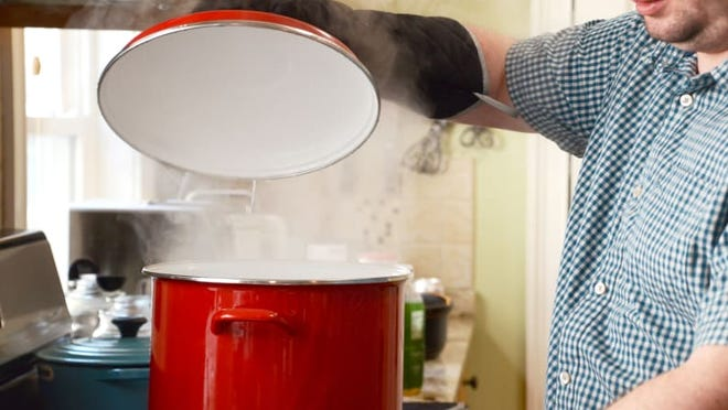 Fill the pot with two inches of water and boil the water over high heat.