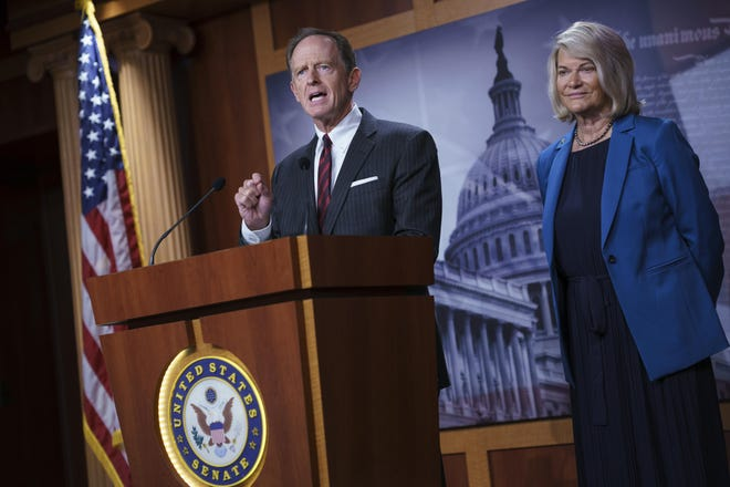 Sen. Pat Toomey, R-Pa., and Sen. Cynthia Lummis, R-Wyo., discuss details of a bipartisan agreement to fix the digital asset reporting requirements in the infrastructure bill at the U.S. Capitol on Monday.