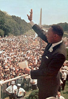 """The Rev. Martin Luther King Jr. acknowledges the crowd in front of the Lincoln Memorial for his """"I Have a Dream"""" speech in Washington, D.C., on Aug. 28, 1963. AP photo"""