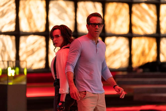 """Jodie Comer, left, and Ryan Reynolds in a scene from """"Free Guy."""""""