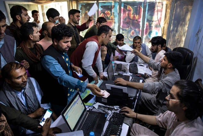 Afghan Special Immigrant Visa applicants crowd into the Herat Kabul Internet cafe to apply for the program Wednesday in Kabul, Afghanistan.