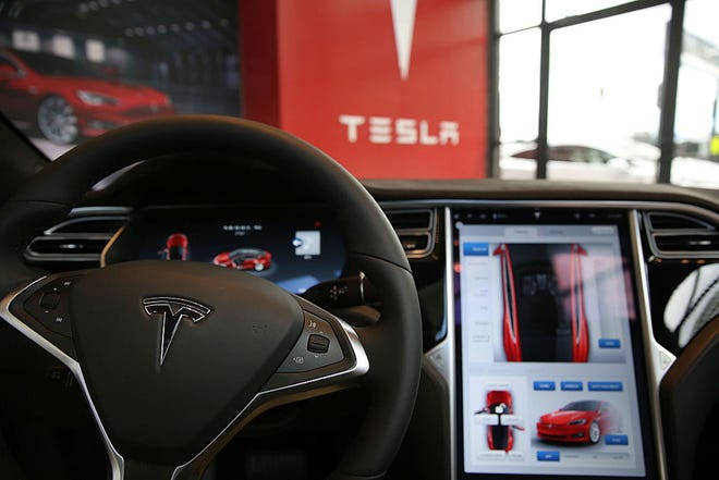 The inside of a Tesla vehicle is viewed as it sits parked in a new Tesla showroom and service center in Red Hook, Brooklyn on July 5, 2016 in New York City. (Spencer Platt/Getty Images/TNS)