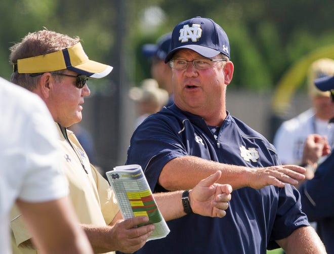 Head coach Brian Kelly (left) still considers retired former Irish offensive line coach Harry Hiestand (right) an asset to the Notre Dame football program.