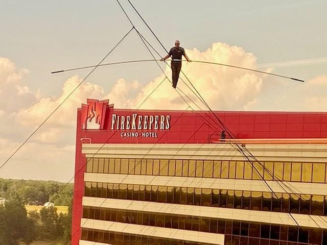 World famous high-wire walker Nik Wallenda defied death by successfully crossing an eight-story high, 400-foot tightrope Monday evening at FireKeepers Casino in Battle Creek.
