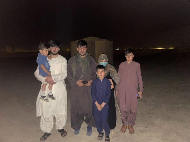 Mohammad Khalid Wardak is seen in Afghanistan on Wednesday after the U.S. military and its allies rescued him and his family. Wardak, a high-profile Afghan national police officer, was being hunted by the Taliban because of his years working with the American military.
