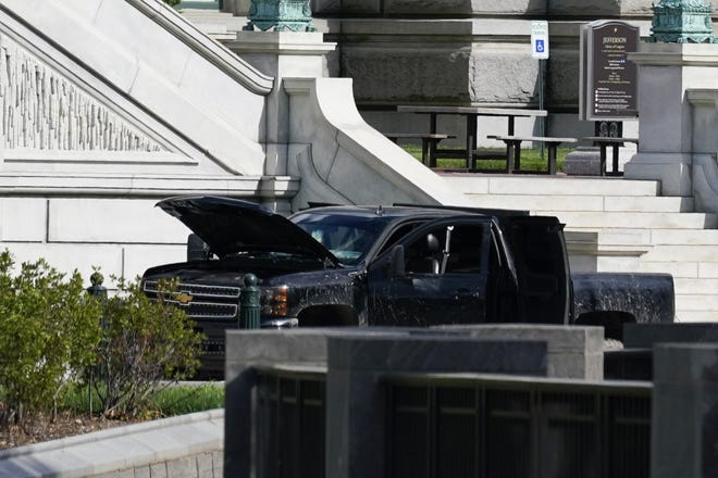 Authorities investigate a pickup truck parked on the sidewalk in front of the Library of Congress' Thomas Jefferson Building, Thursday, Aug. 19, 2021, in Washington. A man who claimed to have a bomb in a pickup truck near the Capitol surrendered to law enforcement after an hourslong standoff Thursday that prompted a massive police response and the evacuations of government buildings and businesses in the area. (AP Photo/Alex Brandon)
