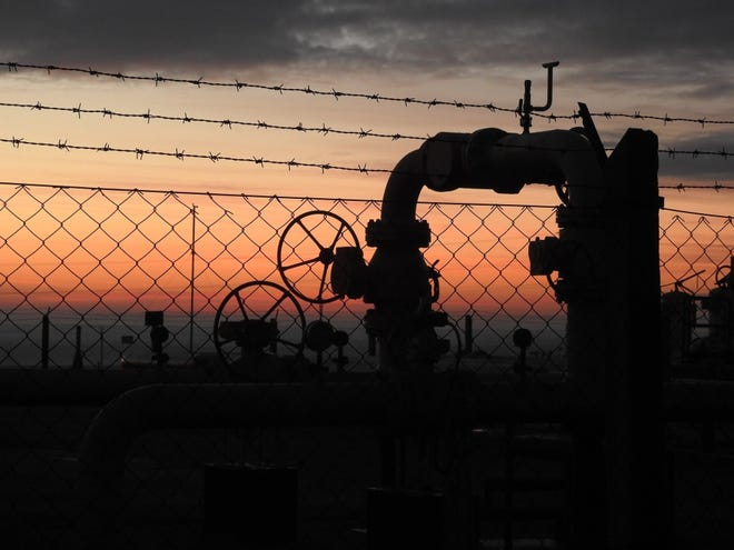 A natural gas pipeline at sunset.