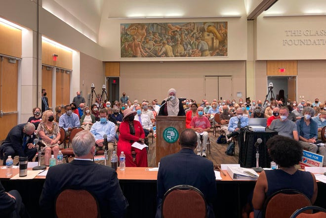 Areeqe Hammad, of Cleveland, testifies at the first public hearing of the Ohio Redistricting Commission at Cleveland State University on Monday.