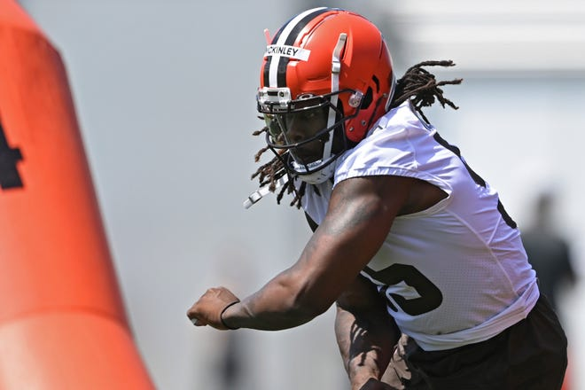 Cleveland Browns defensive lineman Takkarist McKinley (55) runs a drill during an NFL football practice at the team's training facility in Berea, Ohio, on June 15, 2021. McKinley returned to the team and took part in individual drills at practice Wednesday. [David Dermer/Associated Press]