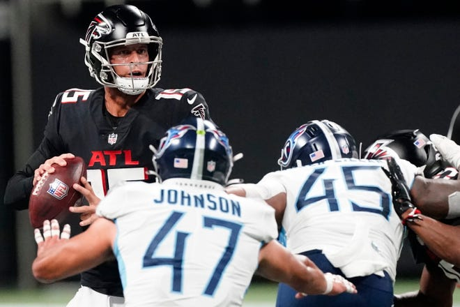 Atlanta Falcons quarterback Feleipe Franks (15) works in the pocket against the Tennessee Titans during the second half of a preseason NFL football game, Friday, Aug. 13, 2021, in Atlanta. (AP Photo/John Bazemore)