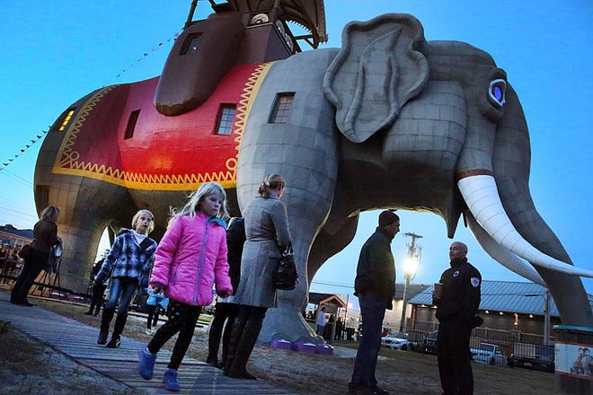 People gather for the lighting of Margate, N.J., landmark Lucy the Elephant on Oct. 29, 2013.