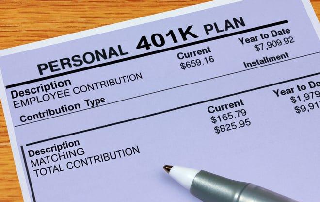 Pen resting on 401(k) statement.