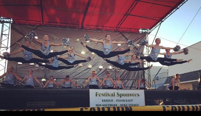 MITCHELL — The Mitchell High School dance team performs on the Main Street stage as part of the Persimmon Festival in this file photo. The 74th annual festival kicks off Sept. 18 with the Candlelight Tour and wraps up Sept. 25 with the grand parade through downtown Mitchell.