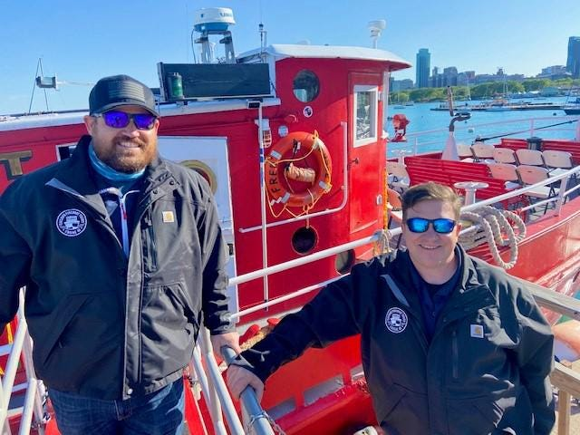 Captains Erich Totsch and Ray Novak take tourists and groups aboard their Chicago fireboat.