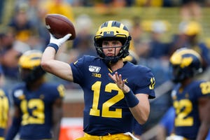 Michigan quarterback Cade McNamara throws during warmups before an NCAA college football game  in 2019 against Middle Tennessee in Ann Arbor, Mich. McNamara will start at quarterback this season for the Wolverines.