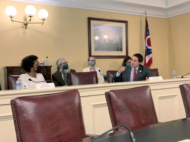 Ohio Elections Chief Frank LaRose, right, talks about his desire for a new, 10-year map of the state's legislative districts at a meeting of the Ohio Redistricting Commission on Tuesday Columbus, as fellow commission member Rep. Emilia Sykes of Akron, the top House Democrat, listens to his statement.