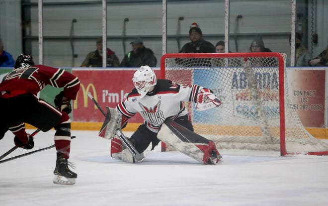 Aberdeen Wings goaltender Jake Sibell tracks down a shot from Minot Minotauros' Blaine Warnert during the second period of Wednesday's game. American News photo by Jenna Ortiz, taken 01/27/2021.