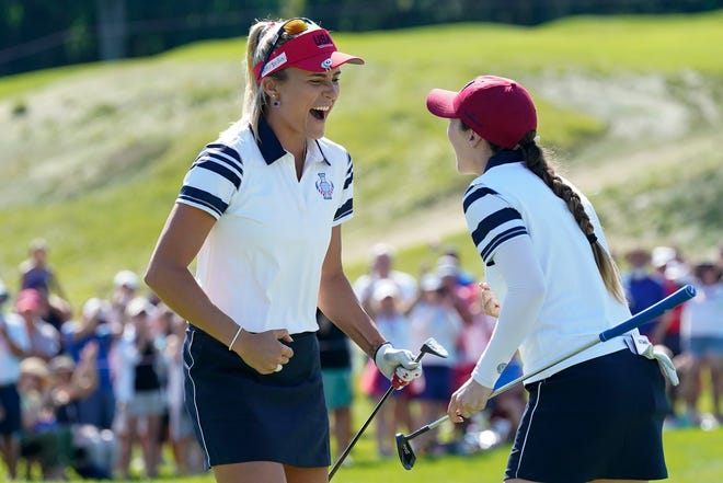 United States' Lexi Thompson and Brittany Altomare celebrate their win against Europe's Charley Hull and Emily Kristine Pedersen on the 17th hole during the foursome matches at the Solheim Cup golf tournament, Sunday, Sept. 5, 2021, in Toledo, Ohio. (AP Photo/Carlos Osorio).