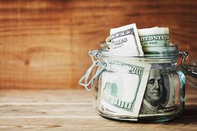 Jar full of hundred dollar bills.