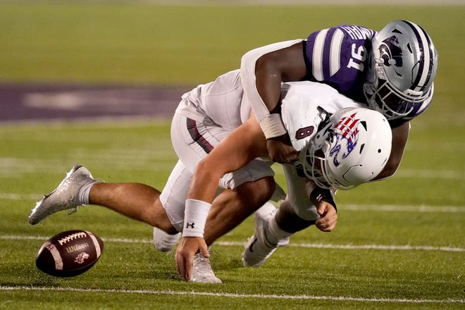 Southern Illinois quarterback Nic Baker (8) fumbles the ball as he is hit by Kansas State's Felix Anudike-Uzomah (91) during the second half last Saturday at Bill Snyder Family Stadium in Manhattan.