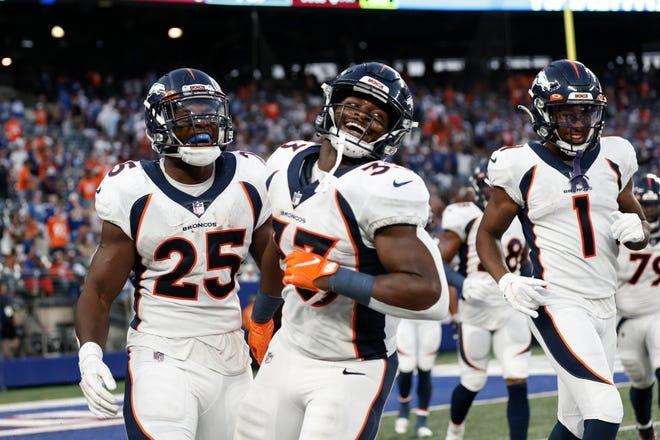 Denver running back Melvin Gordon (25) celebrates a touchdown last week against the New York Giants with teammates Javonte Williams (33) and K.J. Hamler (1).