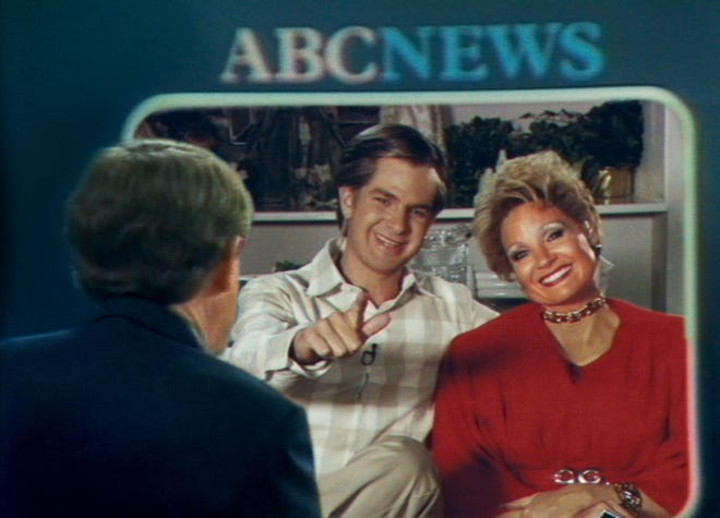 """Andrew Garfield as televangelist Jim Bakker and Jessica Chastain as Tammy Faye in a scene from """"The Eyes of Tammy Faye."""""""