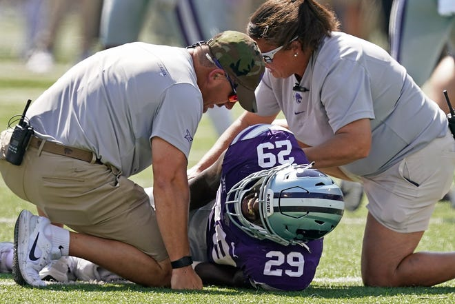 Kansas State defensive end Khalid Duke (29) is helped after being injured during the first half of last Saturday's game against Nevada at Bill Snyder Family Stadium.