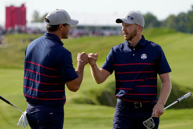 Team USA's Daniel Berger and Team USA's Brooks Koepka celebrate on the 11th hole during a foursome match the Ryder Cup at the Whistling Straits Golf Course Friday, Sept. 24, 2021, in Sheboygan, Wis. (AP Photo/Jeff Roberson)