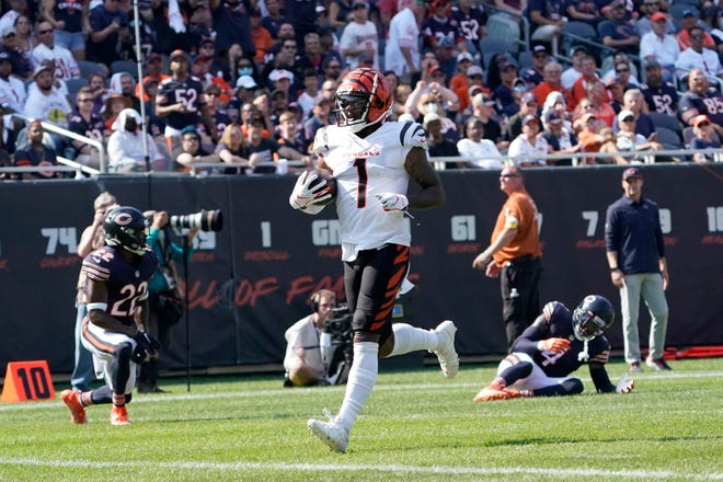 Cincinnati Bengals wide receiver Ja'Marr Chase scores during the second half of an NFL football game against the Chicago Bears Sunday, Sept. 19, 2021, in Chicago. The Bears won 20-17. (AP Photo/David Banks)