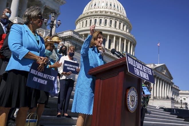 House Speaker Nancy Pelosi, D-Calif., shown Friday at a rally outside the Capitol, vowed Sunday to pass a bipartisan infrastructure bill this week.