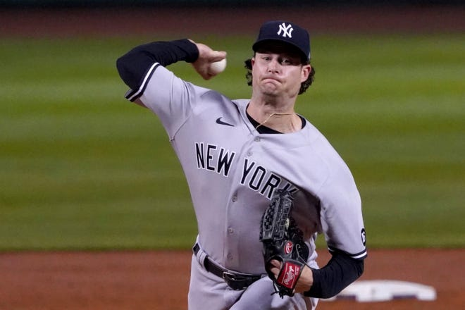 New York Yankees starting pitcher Gerrit Cole (45) throws to a Boston Red Sox batter during the first inning of a baseball game at Fenway Park, Friday, Sept. 24, 2021, in Boston. (AP Photo/Mary Schwalm)