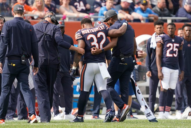 Chicago Bears running back David Montgomery is assisted off the field during the second half of an NFL football game against the Detroit Lions Sunday, Oct. 3, 2021, in Chicago. The Bears won 24-14. (AP Photo/David Banks)
