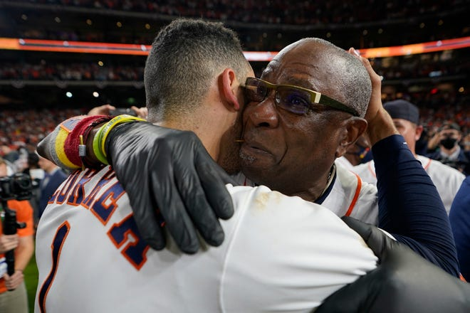 Houston Astros manager Dusty Baker Jr. and shortstop Carlos Correa celebrate their win against the Boston Red Sox in Game 6 of baseball's American League Championship Series Friday, Oct. 22, 2021, in Houston. The Astros won 5-0, to win the ALCS series in game six. (AP Photo/David J. Phillip)