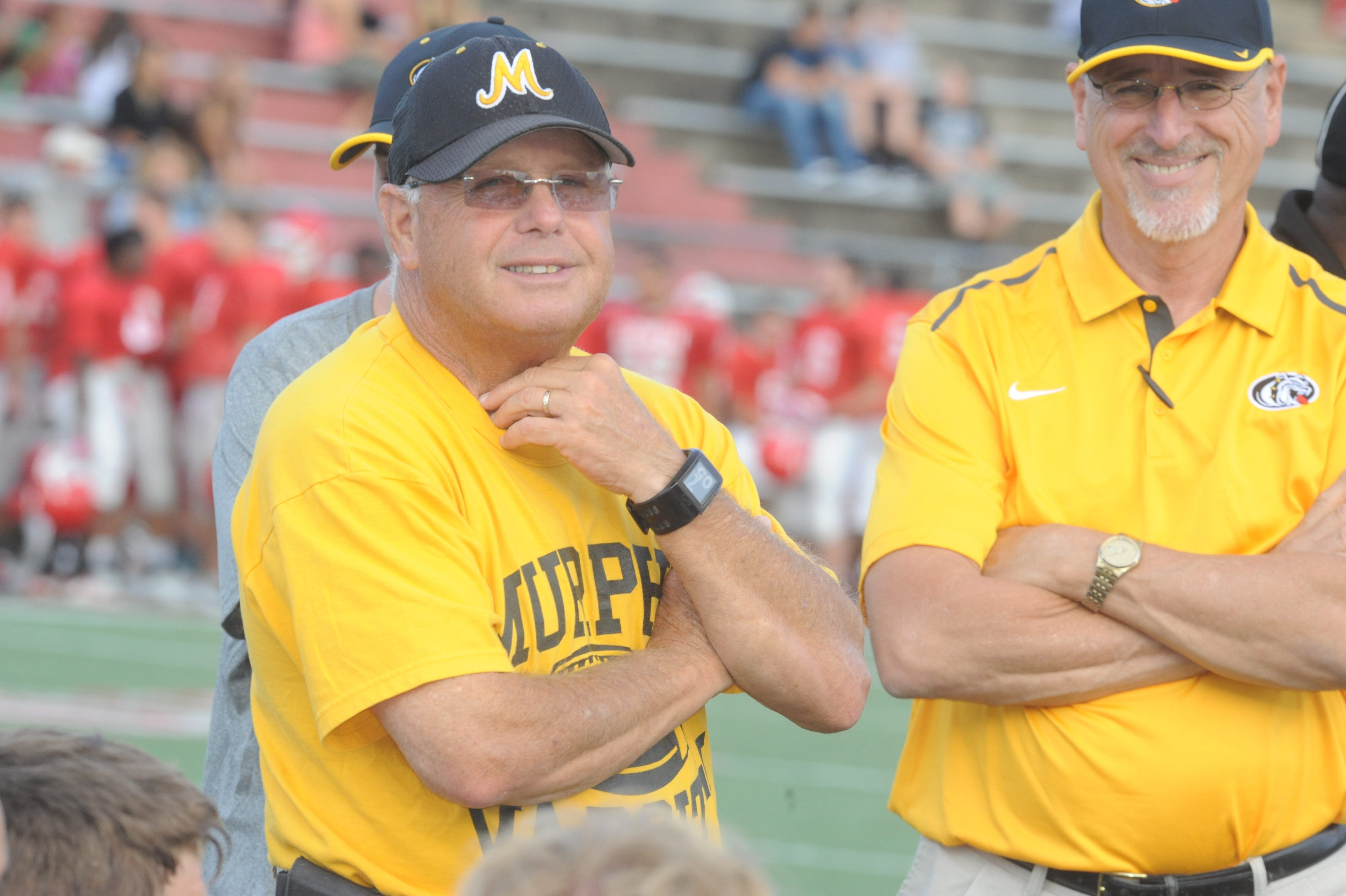 David Gentry, left, has been the football coach at Murphy since 1983 and won a Western North Carolina-record 346 games.