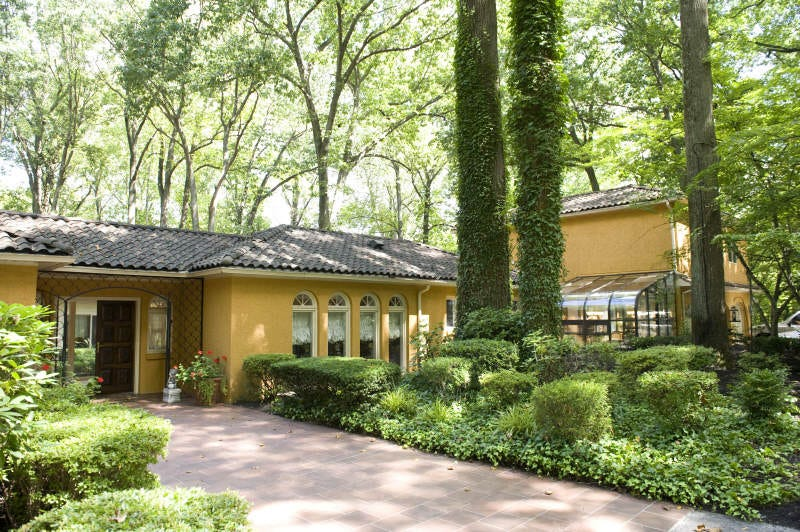 A 10,000-square-foot Tuscan-style villa in Cherry Hill that boxing great Muhammad Ali bought in 1971 and sold in 1974 is scheduled for auction on Sept. 8. Wednesday, August 29, 2012.