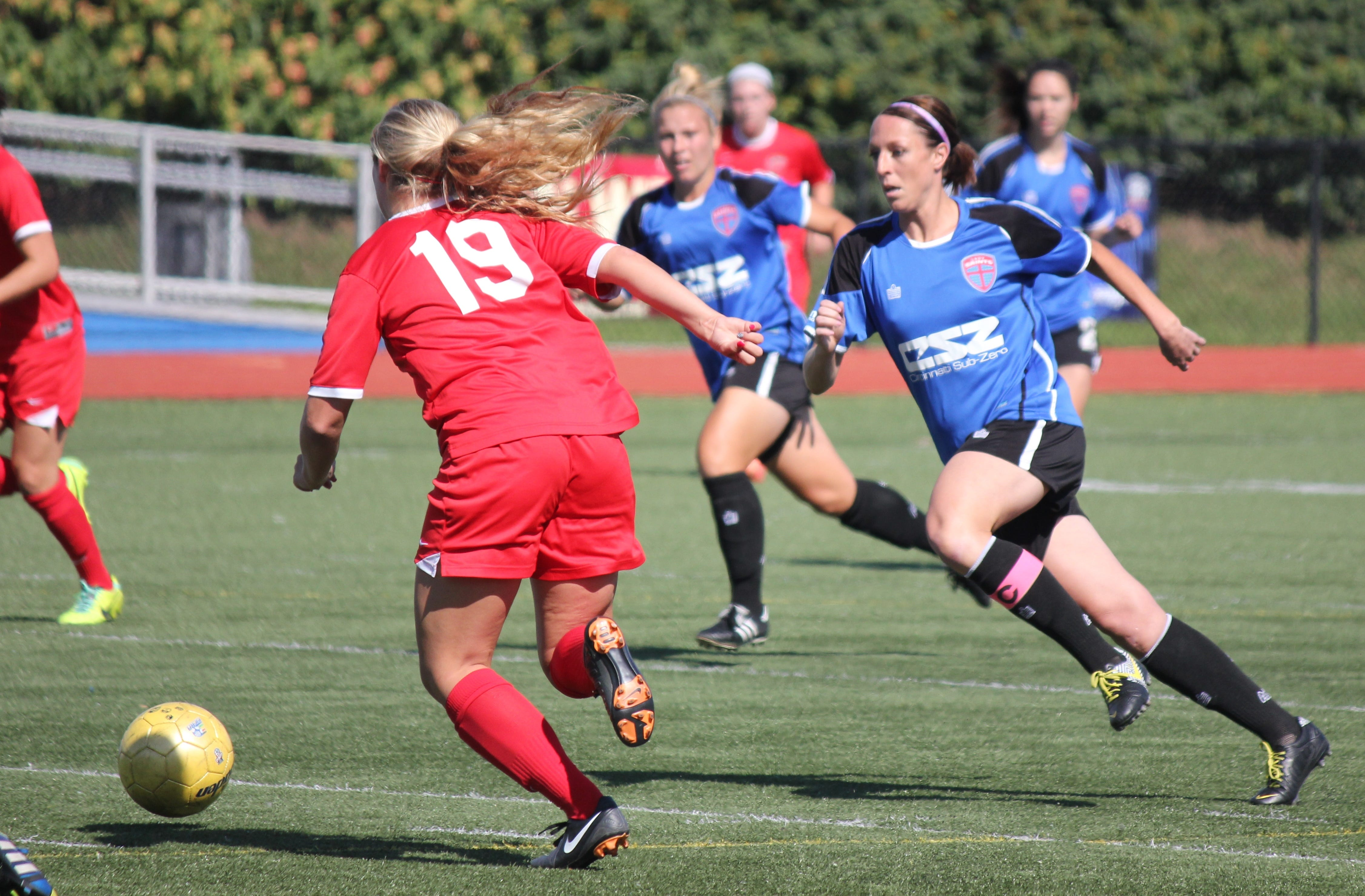 Lady Saints co-captain Kim Comisar-Granell (Lakota West/Purdue) goes for the ball at midfield in the July 5 game against FC Pride