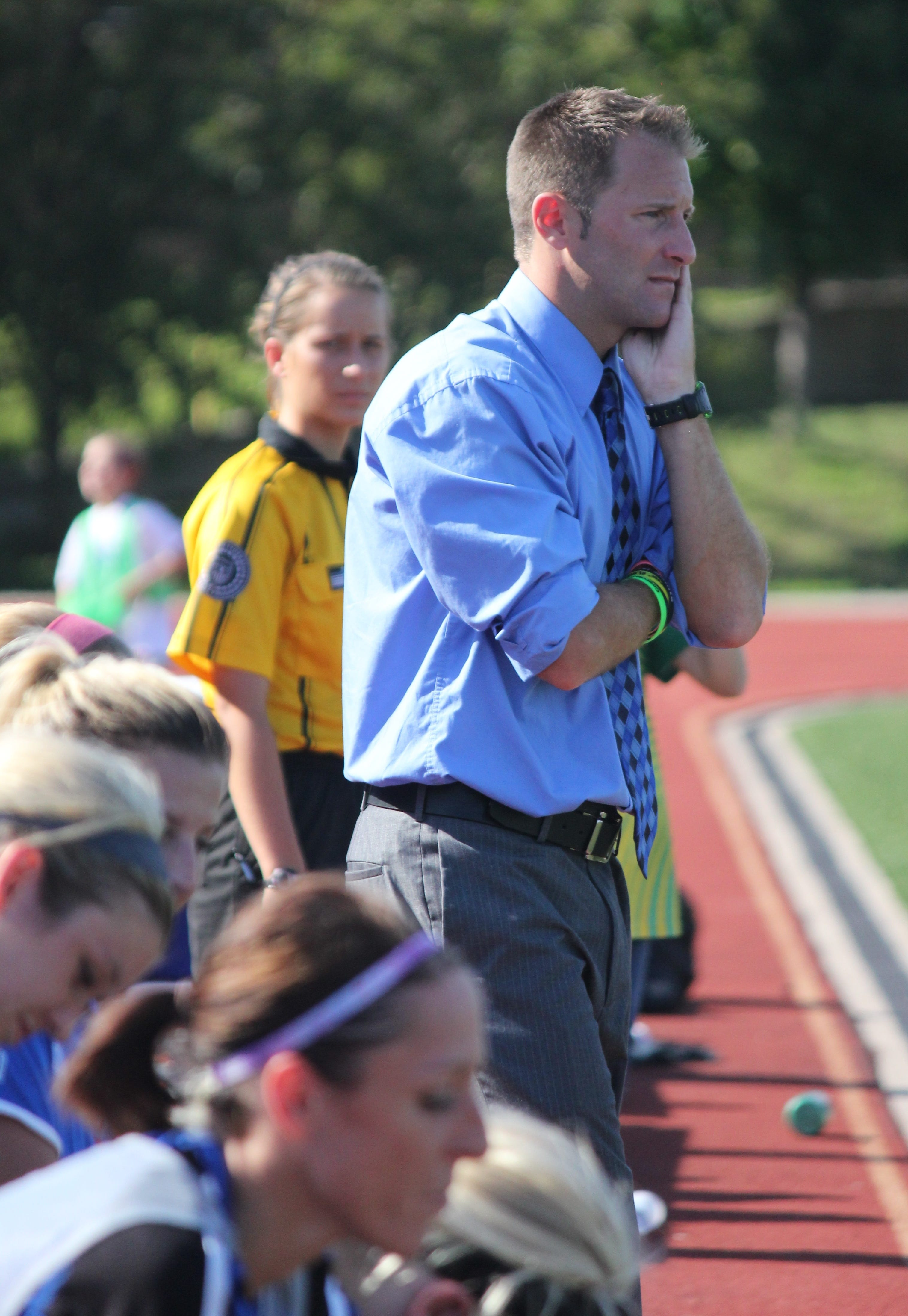 Head coach Joe Talley - also head coach for Finneytown boys soccer team - watches his Lady Saints in the second half of the July 5 game against FC Pride. The team won 4-0 at home, Stargel Stadium.