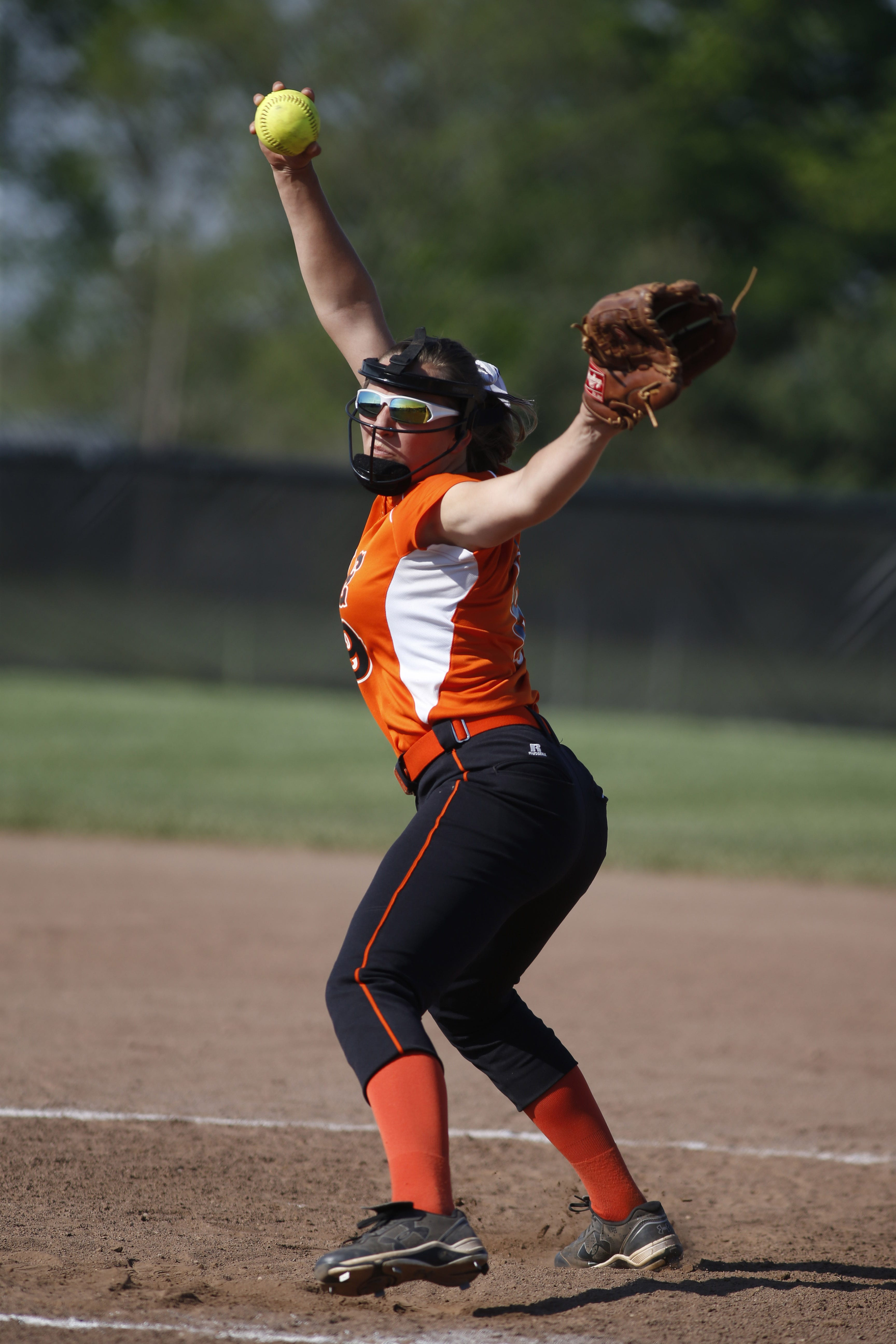 Ryle High School's Ali Crupper, pitching against Notre Dame Academy last May, is a Northern Kentucky pitcher who has worn face masks while pitching.