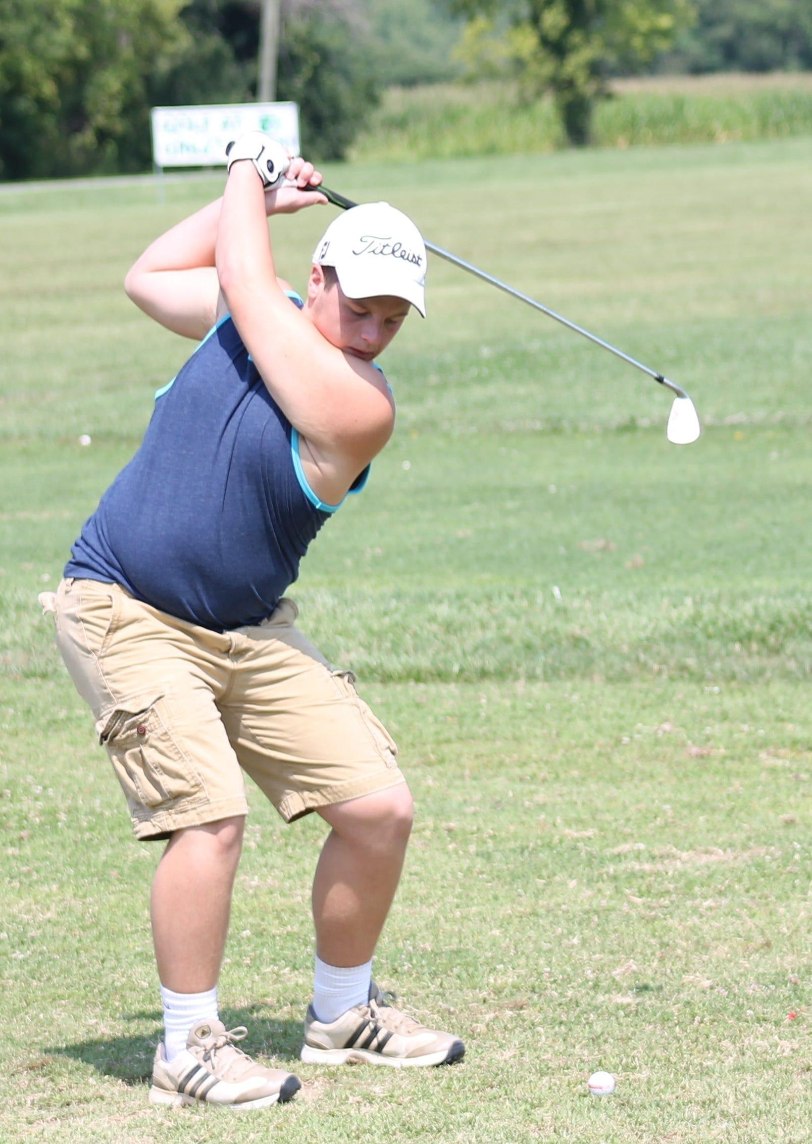 Bethel-Tate junior Jacob Dahlheimer bends the club at Friendly Meadows Aug. 1.