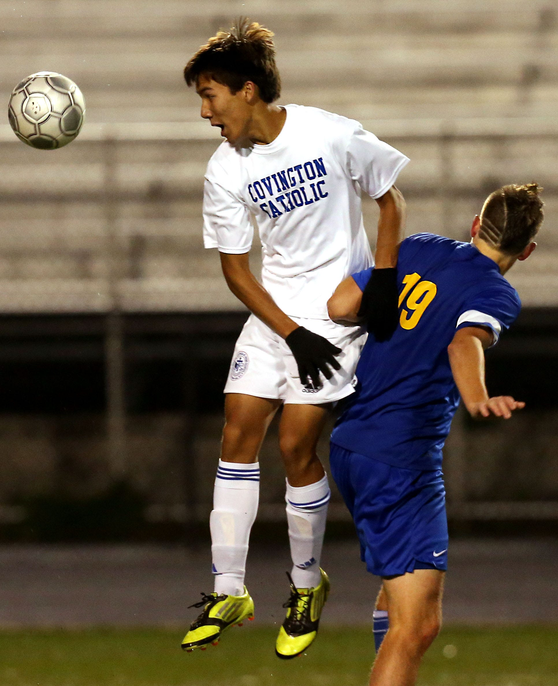 Covington Catholic's Joe Schuh (4) heads the ball against Newport Central Catholic's Noah Connolly (19) in a soccer game at Ryle High School Oct. 24, 2013. Newport Central Catholic won 1-0 in overtime.